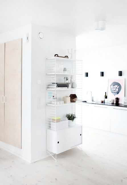 Swiss Mod Kitchen :: I love the use of storage space in this kitchen. Everything is organised and cute at the same time.