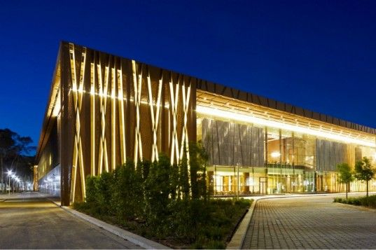 Libya's Stunning Tripoli Congress Center is Protected by a Tree-Inspired Mesh Facade    Read more: Libya's Stunning Tripoli Congress Center is Protected by a Tree-Inspired Mesh Facade | Inhabitat - Green Design Will Save the World
