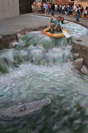 This guy does amazing 3-D chalk art on sidewalks ~ this picture is actually flat!