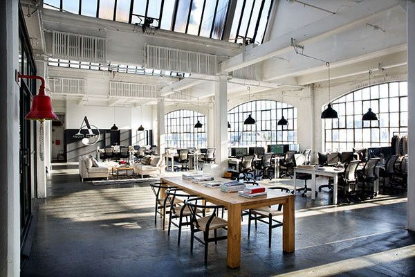 """from the movie """"The Intern."""" Office interior design. Simple. Pendant lights. Wood conference / lunch table. Simple desks. Concrete floors. Big windows. Skylights."""