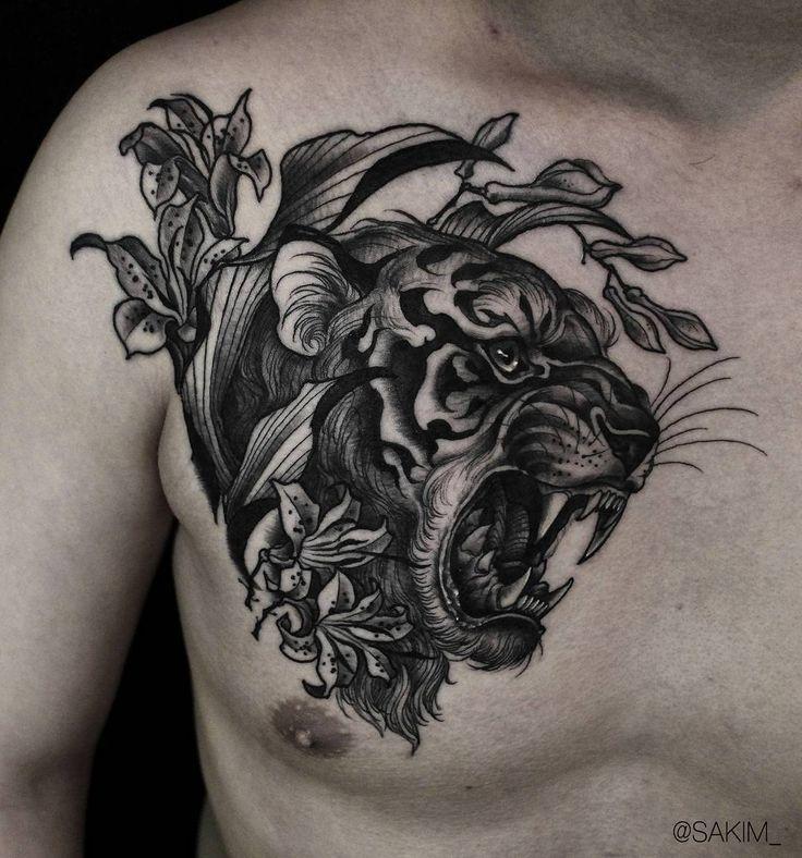 blackwork tiger head tattoo on chest by @sakim__