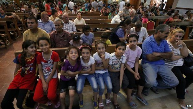 Up to a quarter of Iraq's Christians are reported to be fleeing after Islamic militants seized the minority group's biggest town.