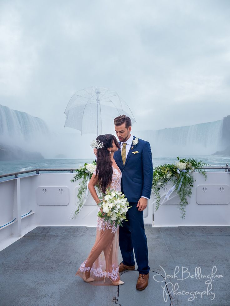 The most stunning wedding photograph ever! Bride and Groom under Niagara Falls, the most iconic wedding and elopement spot in the world! Hornblower Niagara Cruises provides you with a chance to get married right under Niagara Falls. #JoshBellinghamPhotography
