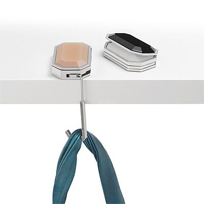 Designed by a NASA engineer, this breakthrough girl gadget stores a mirrored compact and palm-sized, retractable hanger that keeps your purse away from chair backs and off the floor. Simply unleash its hook and let your bag hang gracefully from the table.
