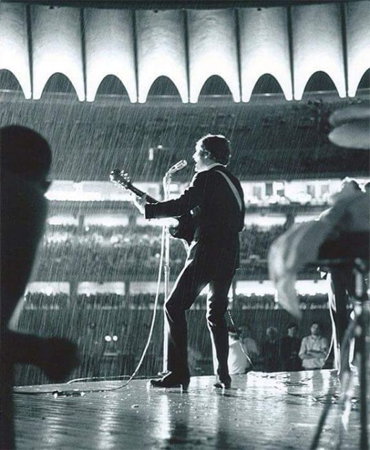 The Beatles in the rain, 8/21/66, St. Louis