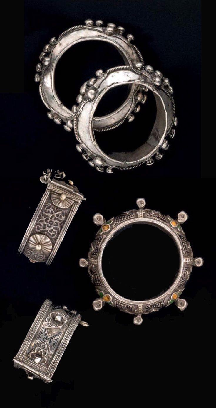 Morocco | 1) Pair of silver bracelets from the Bani Oasis, Guelmim region. 2) Silver and enamel bracelet from the Tafraout region and 3) Two old silver hinge bracelets from the Central Anti Atlas region | Est. 1'200 - 1'500€ ~ (June '14)