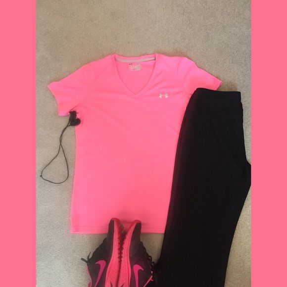Under Armour workout top Size large, semi fitted, heat gear. V neck. No signs of wear. Under Armour Tops Tees - Short Sleeve