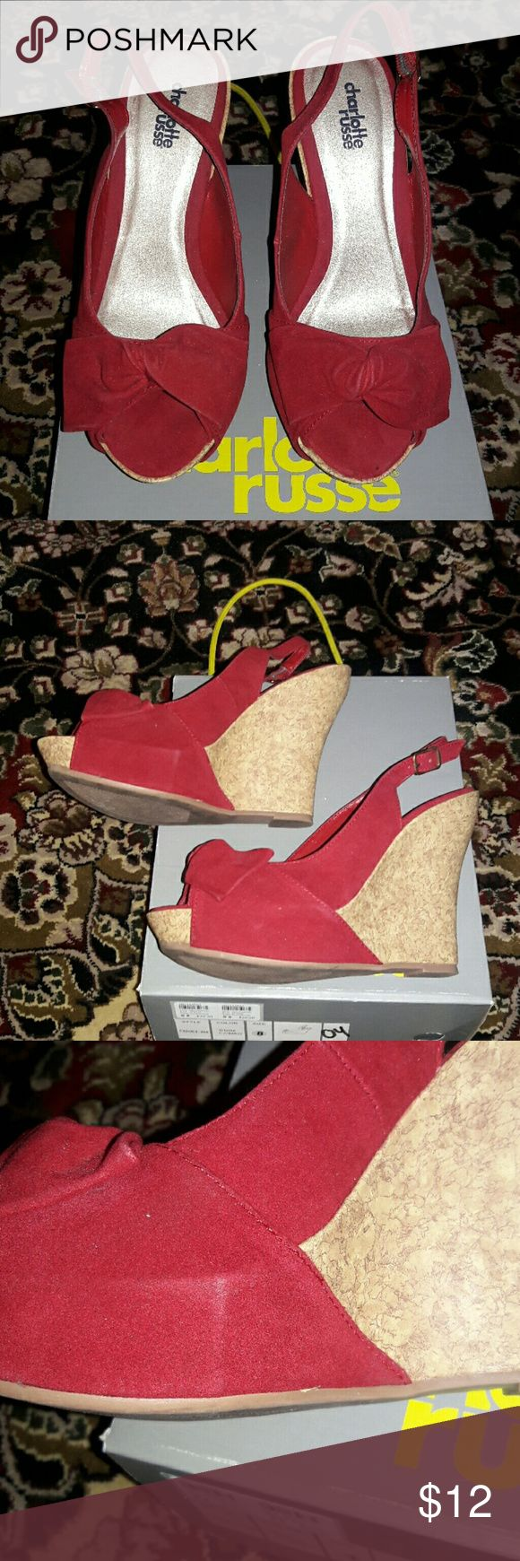 Red wedges Red seude-ish wedges with a bow on top. Cork material on back heel.  Worn just a few times.  Still lots of wear left.  Slight fabric impression on right inside shoe.  (Shown in picture) Charlotte Russe Shoes Wedges