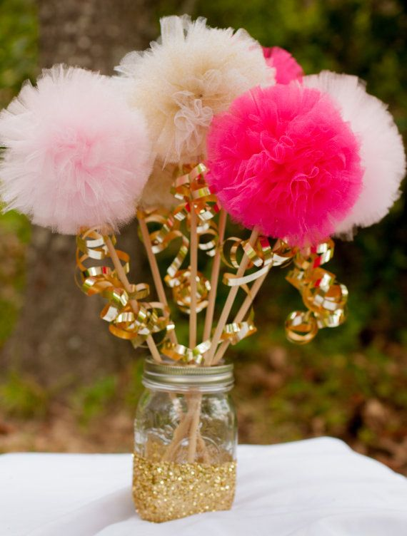 Pink and gold pom wands princess party centerpiece