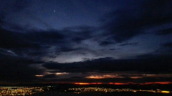 View over Port Elizabeth as we land. Sunset and city lights. South Africa