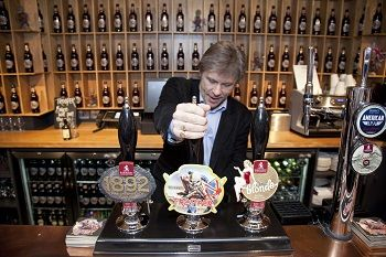 Iron Maiden front man Bruce Dickinson pours a pint of the new Trooper beer made and produced by Stockport based Robinsons Brewery. #beer #ironmaiden