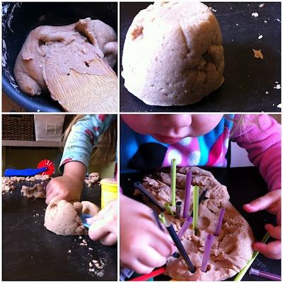 Sand Dough by A Childhood List. Looks like wet sand and holds its shape well.