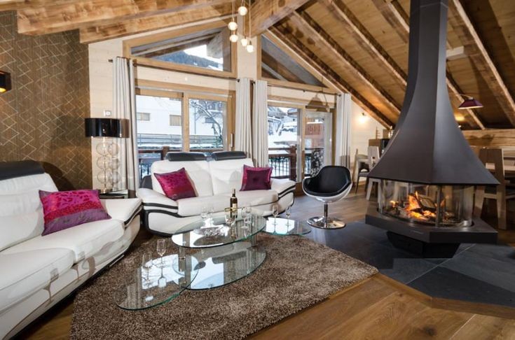 Log fire in chalet lounge