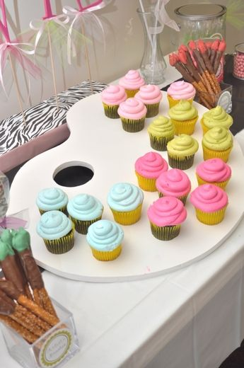 IDEA: The palette was cut from double thick foam core board and propped at an angle to display the cupcakes.