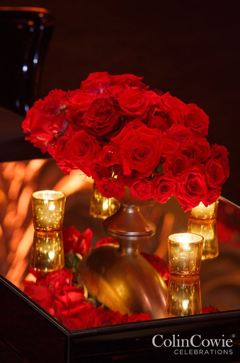 Gorgeous red roses are paired with gold votive candles for a chic, royal feel. Click to view our wedding roses gallery with over 150 stunning rose images.