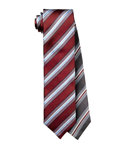 FROM TUESDAY: This tie duo from Canali give this man options. The shades of grey with red, or red with shades of grey and a few hues of blue. These pure silk ties are a great pick for a business man.