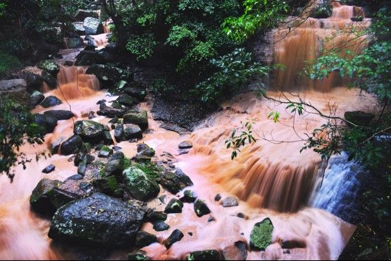 Kembla Falls at Mount Kembla after torrential rain and the water turning an unusual muddy colour.