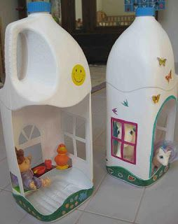 Play houses from milk cartons. I want to do this with cardboard milk cartons so the houses have peaked roofs!