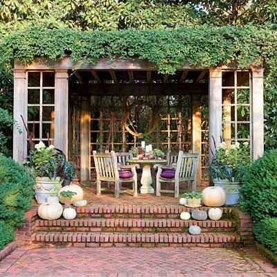 Fall Garden Terrace | This garden terrace is given fall flair with with and gray pumpkins. If you can't find these varieties locally, try spray paint. | SouthernLiving.com