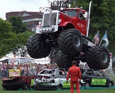 Monster trucks flying through the air crushing smaller girly man cars!