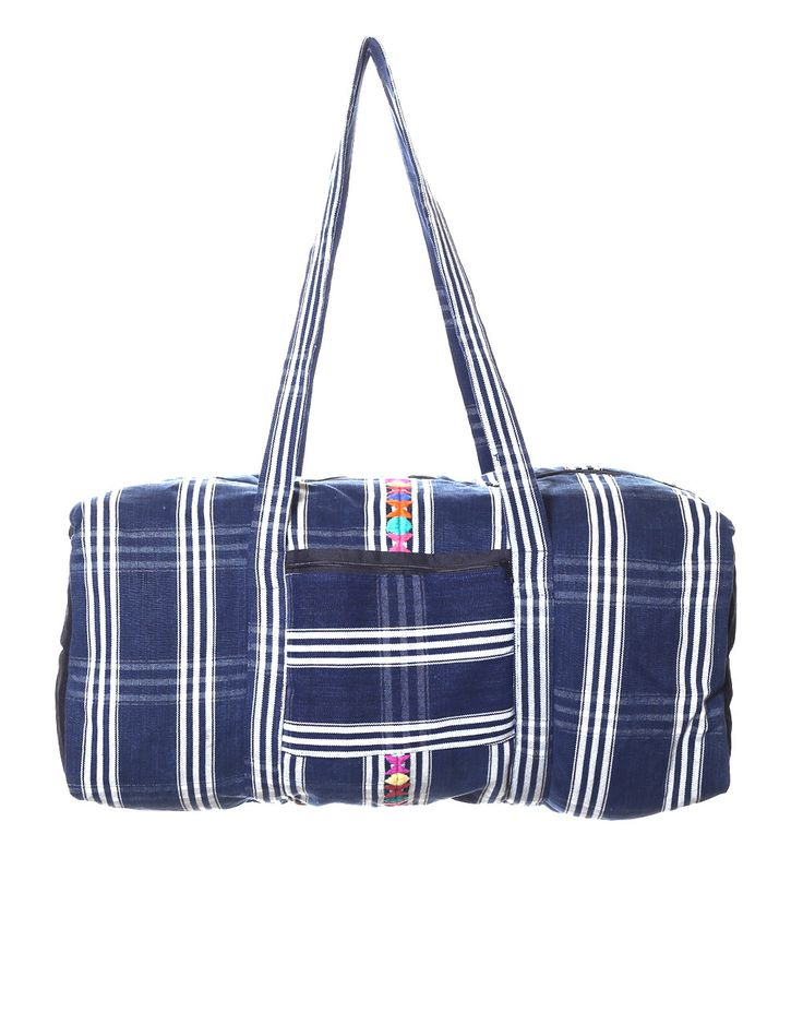 - Description - Artisan - Corte - Hang Tag Handmade in Guatemala from the fabric of a traditional Guatemalan skirt, this one-of-a-kind duffle bag is the perfect size for weekend adventures. Each bag i
