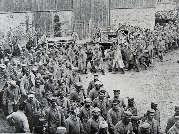 World War 1 - German prisoners of war parade through a farmyard, 1915 © Fotolibra