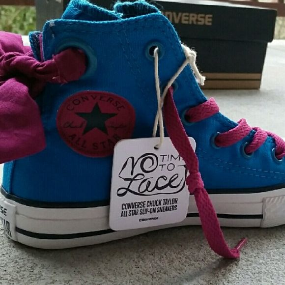 Converse All Stars Girls High Top Sneakers NIB Brand new in box pair of girls Converse sneakers. Blue with pink colored bows in back.  Adorable.   Size 13 Converse Shoes