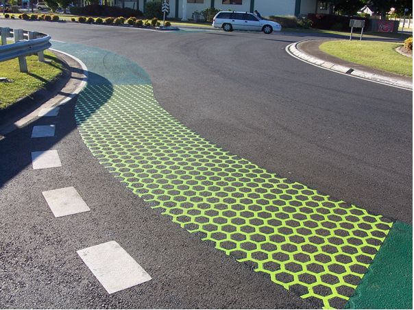 green bike lane, love the idea of visibly differentiating at a roundabout but with a distinct bicycle location