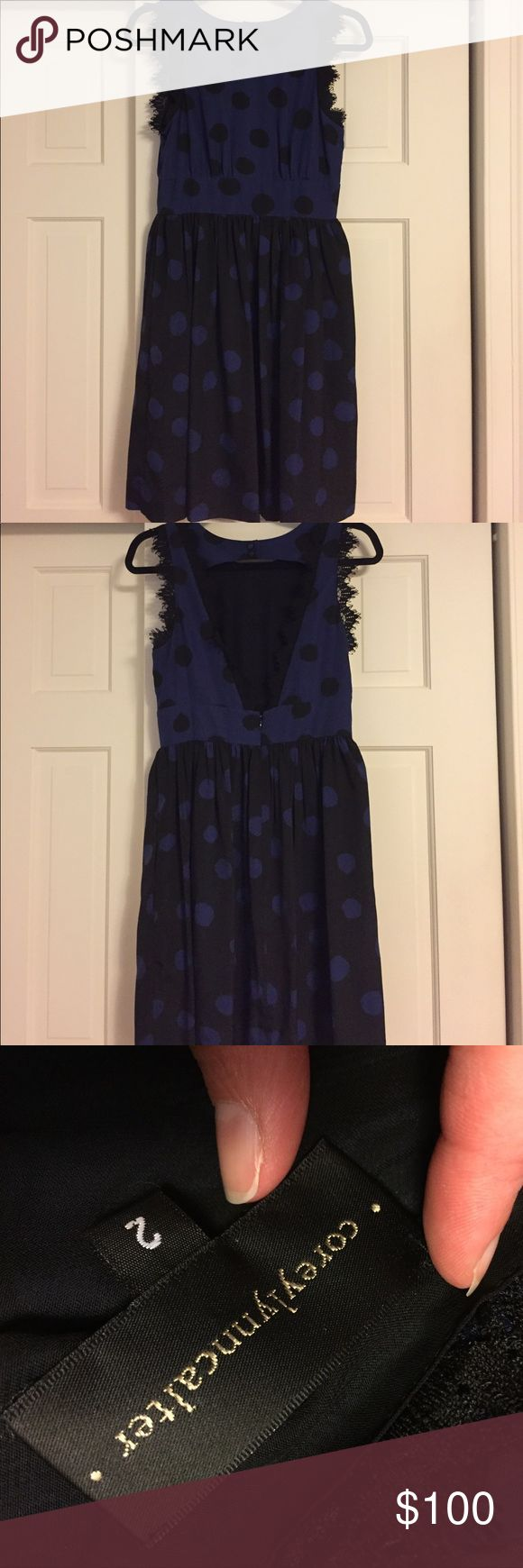 Beautiful open back navy and black cocktail dress Women's size 2 Coreylynncalter - from Anthropoligie  Black and navy/blue polka dot dress - has pockets! Anthropologie Dresses Mini