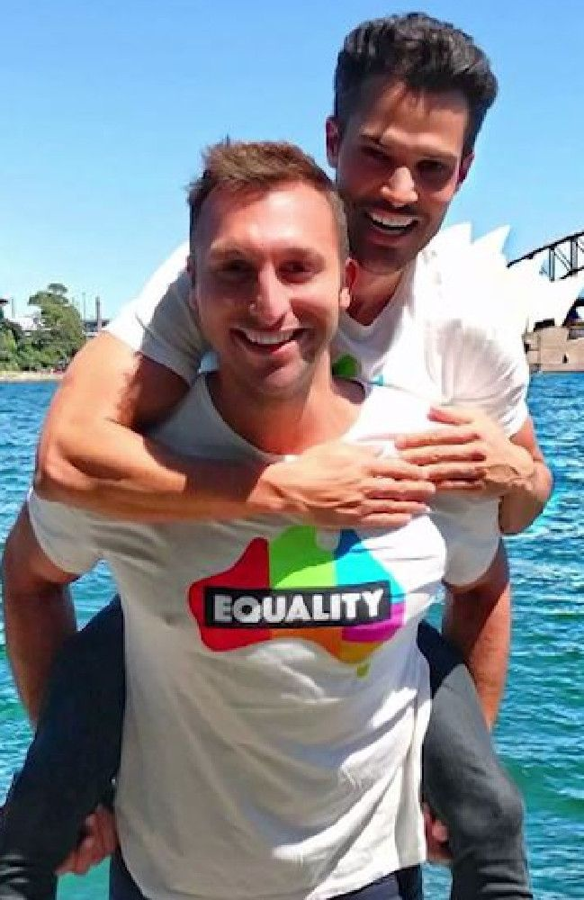 Olympic gold medalist Australian swimmer Ian Thorpe with his partner Ryan Channing. source ABC