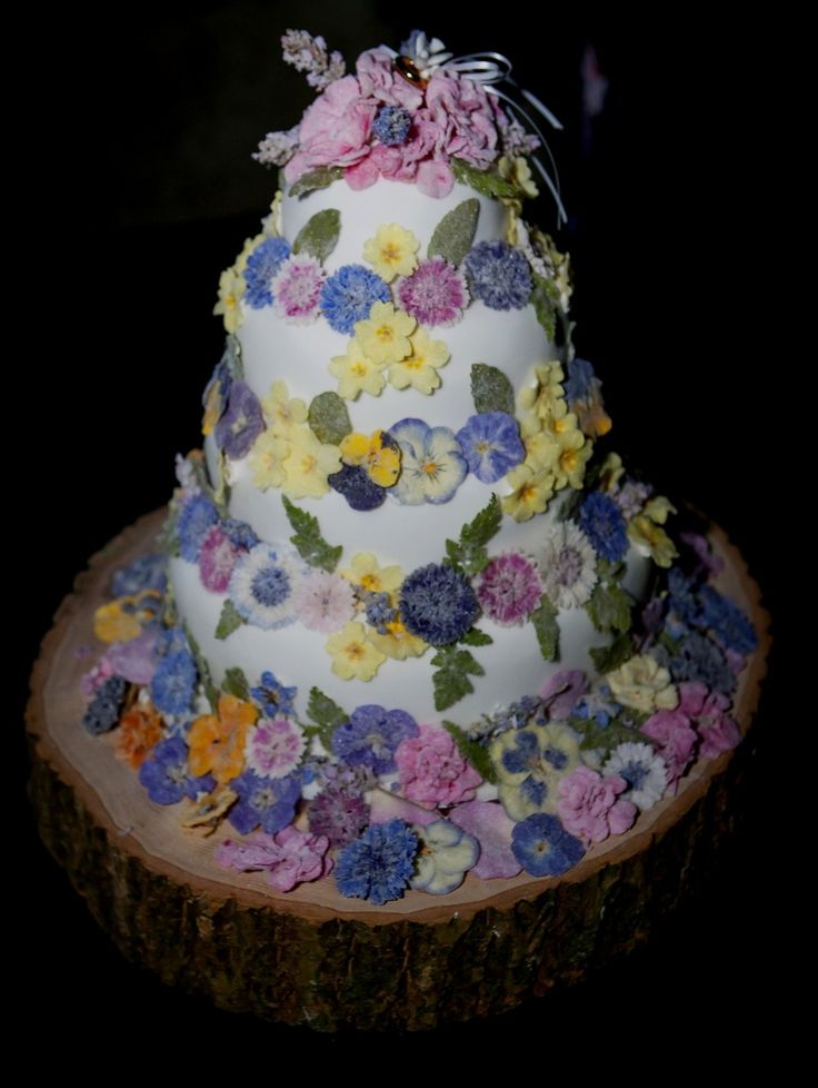 Beautiful 4 tier wedding cake decorated with Meadowsweet Crystallised Flowers.