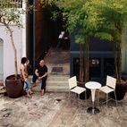 """Yang Yeo and his girlfriend Ching Ian relax on the back stoop of their renovated and radically updated Singapore shophouse—an archetypal building type in this busy port city. """"Shophouses brought back memories of our childhood,"""" says Yeo.  Photo by Richard Powers."""