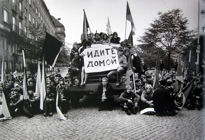 "Prague spring 1968 : protesters holding poster ""Go Home"""