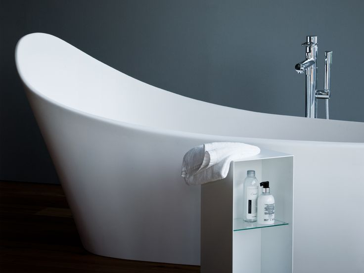 Make a statement with a freestanding bath like the, @laufenbathrooms PALOMBA COLLECTION Solid Surface Bath