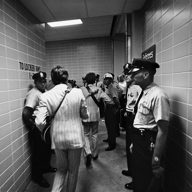 Paul and John backstage at Shea Stadium on the 23rd August 1966.  Look at his butt! haha