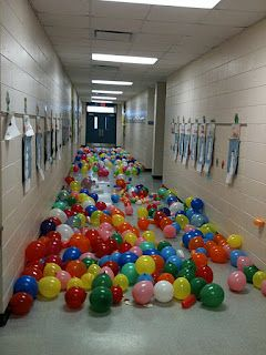 I like this idea. this teacher use it for the 100th celebration but I can see this as an activity that can be use anytime the kiddos have good behavior!    Kids stomp and sit on the ballons to pop them