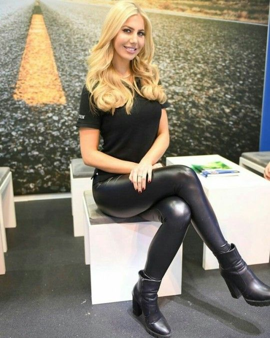 Cute blonde in black leather leggings and ankle boots ...