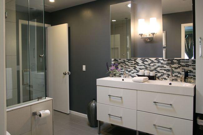 Dark gray walls-CHECK. Black/gray/white glass tile-CHECK.   IKEA Gloss White Cabinets-NEXT.