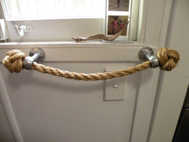 Rope towel holder using marine eyelets for coastal bathroom theme