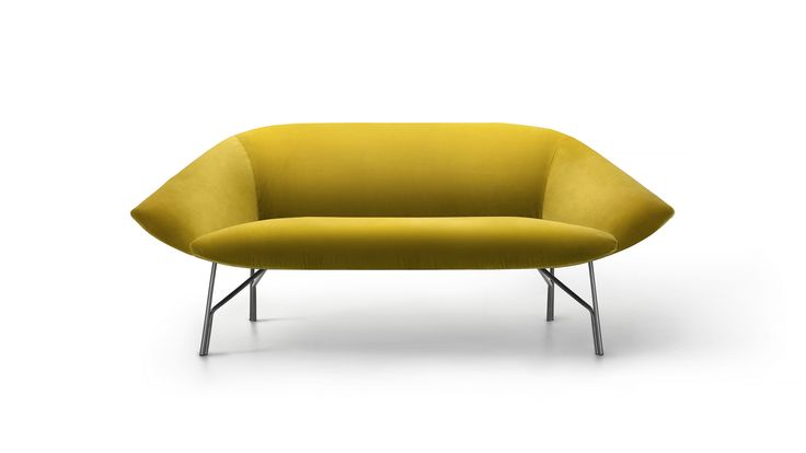 LEMA   Lennox by Gordon Guillaumier, Salone del Mobile 2017.    A retro feel with contemporary balance distinguishes LENNOX, the two-seater sofa which echoes the inviting lines of the lounge chair of the same name. The design was inspired by the open petals of a flower suspended on the light structure of bronze-finished metal. The result is an elegant, discreet conversation sofa, ideal to complete refined lounge making waiting times pleasant.