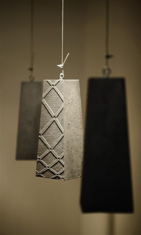 I love the surface design on these concrete pendants | lighting | interior design