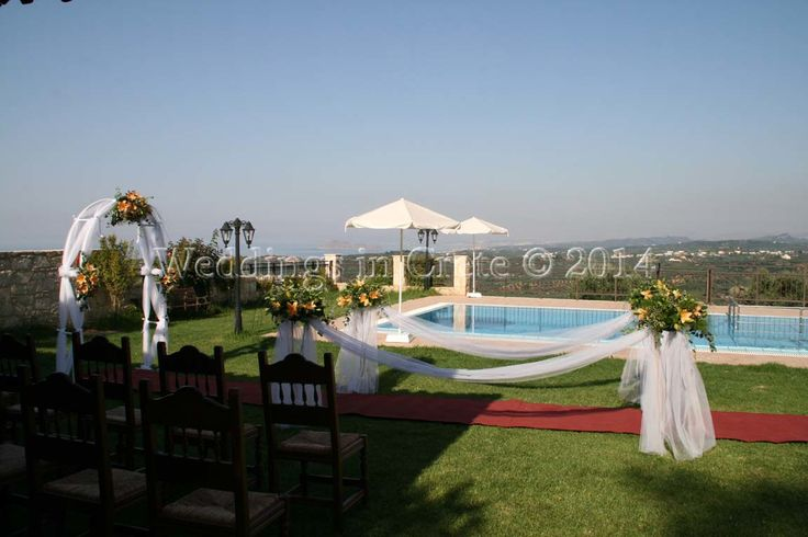 Weddings in Crete - Wedding Arch, Red Carpet and Flower Stands.  Villa Ceremony, Chania area