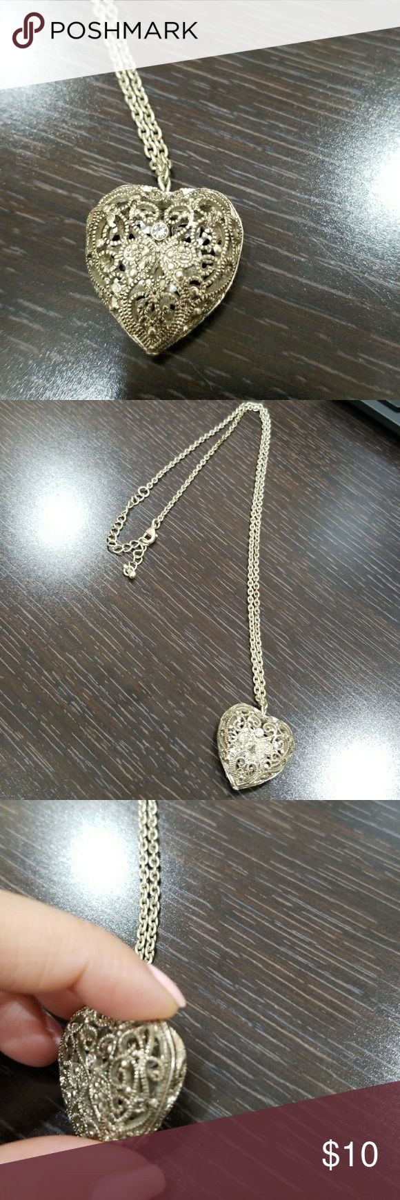 SILVER HEART SHAPPED HOLLOWED OUT NECKLACE LONG NECKLACE. WORN MAYBE TWICE Jewelry Necklaces
