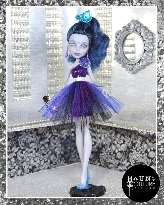 These ensembles work for any of your ghouls but looks GOREgeous on your robot girl. Comes with purple holographic metallic mini dress with