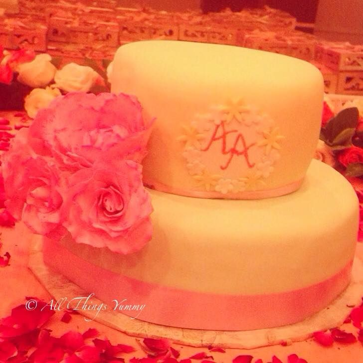 The engagement cake for the cutest couple  #cake #engagement #engagementcake #customisedcake #designercake #weddingcake #wedmegood #wedding #sugarflowers #peony #roses #baileys #chocolatecake #initials #party #atyummy #desserts #baked
