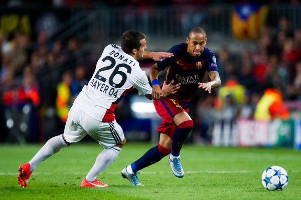 Neymar Santos Jr of FC Barcelona fights for the ball with Guilio Donati of Bayer 04 Leverkusen during the UEFA Champions League Group E match between FC Barcelona and Bayern 04 Leverkusen at Camp Nou on September 29, 2015 in Barcelona, Catalonia.