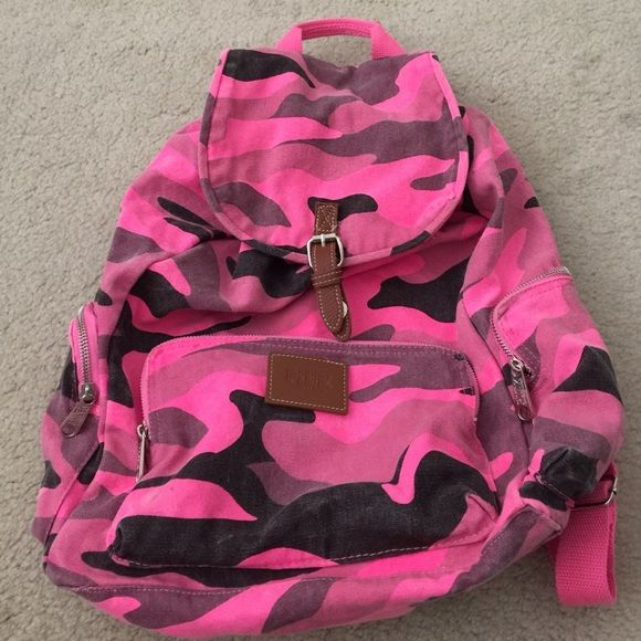 Victoria's Secret pink camo backpack Super cute Victoria's secret pink backpack. Has 1 large inside compartment, 1 front zippered compartment & 2 side zippered compartment. Good used condition. Some fading from washing & a few tiny marks on the pink part. Drawstring closure w a snap & adjustable straps. PINK Victoria's Secret Bags Backpacks