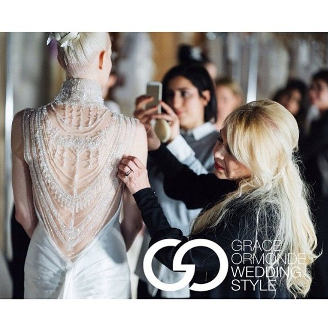 Finishing touches with our Abigail gown captured by @mikecolon. @wedding_style #inesdisanto #inesdisantorunway
