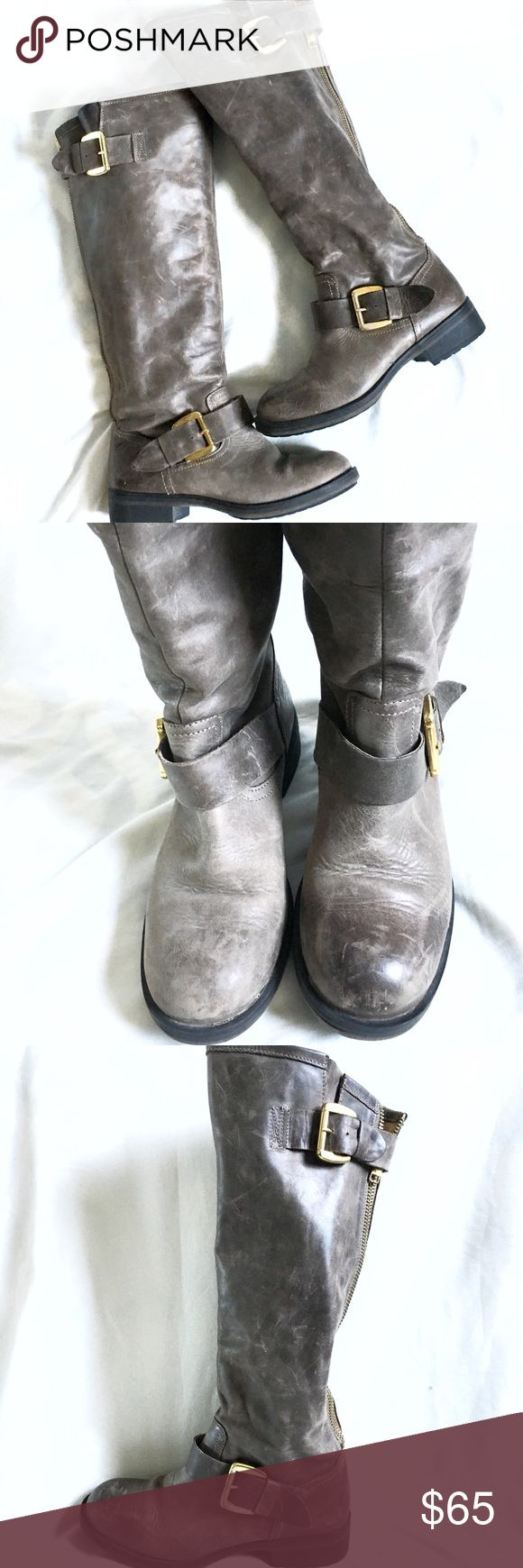 Steve Madden Moto Boot Grey leather boots? Yes please! A must have item in the closet. Grey pairs well with almost any color and gives another option other than black. These boots have a bit of a rugged edge look while still keeping it classy 👌🏽.  ⭐️genuine leather  ⭐️functional heavy duty back zipper ⭐️great preloved condition. Several scratches in the leather. These can be buffed out with a nice leather conditioner, or left alone for a more distressed look. Which is how we would prefer…