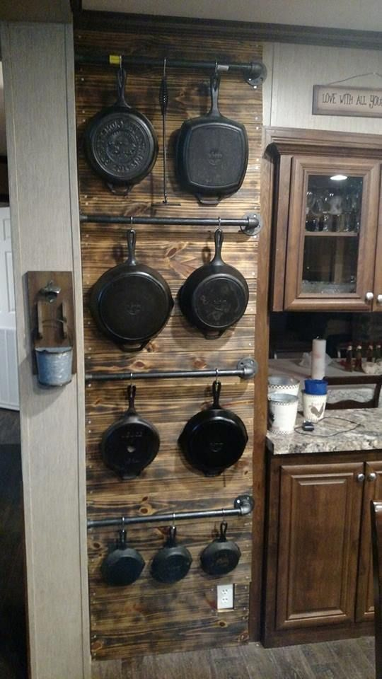 Hanging cast iron pans on metal rods... on a shiplap wall or reclaimed wood accent wall